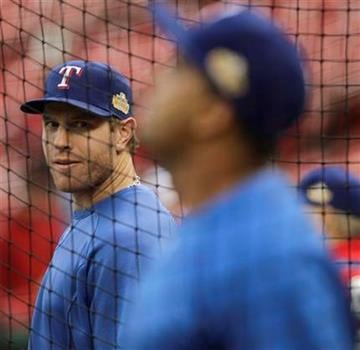Texas Rangers' Josh Hamilton, left, looks over to teammate Nelson Cruz during batting practice before Game 2 of baseball's World Series against the St. Louis Cardinals Thursday, Oct. 20, 2011, in St. Louis. (AP Photo/Paul Sancya) By Paul Sancya