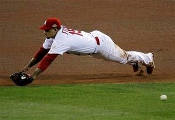 St. Louis Cardinals' David Freese can't come up with a hit by Texas Rangers' Ian Kinsler during the sixth inning of Game 2 of baseball's World Series Thursday, Oct. 20, 2011, in St. Louis. (AP Photo/Jeff Roberson) By Jeff Roberson