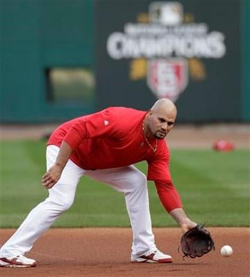 St. Louis Cardinals' Albert Pujols fields a ground ball before Game 2 of baseball's World Series against the Texas Rangers Thursday, Oct. 20, 2011, in St. Louis. (AP Photo/Paul Sancya) By Paul Sancya