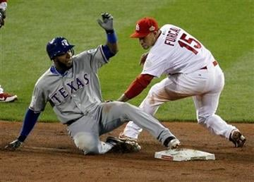 Texas Rangers' Elvis Andrus slides into second beating the tag by St. Louis Cardinals' Rafael Furcal during the ninth inning of Game 2 of baseball's World Series Thursday, Oct. 20, 2011, in St. Louis. (AP Photo/Jeff Roberson) By Jeff Roberson