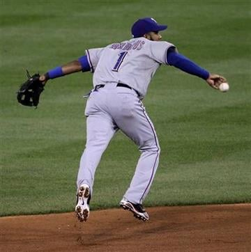 Texas Rangers' Elvis Andrus starts a double play on a ball hit by St. Louis Cardinals' Matt Holliday during the fourth inning of Game 2 of baseball's World Series Thursday, Oct. 20, 2011, in St. Louis. (AP Photo/Paul Sancya) By Paul Sancya