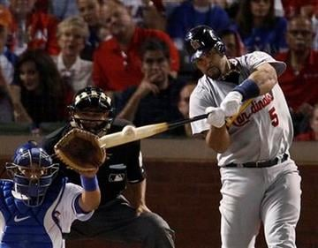 St. Louis Cardinals' Albert Pujols hits a three-run home run during the sixth inning of Game 3 of baseball's World Series against the Texas Rangers Saturday, Oct. 22, 2011, in Arlington, Texas. (AP Photo/Eric Gay) By Eric Gay