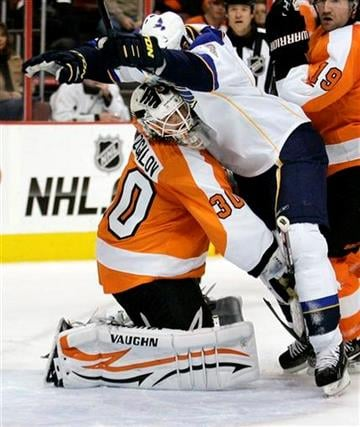 Saint Louis Blues' Jason Arnott collides with Philadelphia Flyers goalie Ilya Bryzgalov during the first period of an NHL hockey game, Saturday, Oct. 22, 2011, in Philadelphia. No penalty was called. (AP Photo/Tom Mihalek) By Tom Mihalek