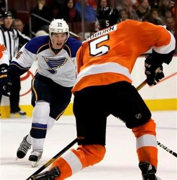 Saint Louis Blues' T.J. Oshie, left, charges towards Philadelphia Flyers' Braydon Coburn during the first period of an NHL hockey game, Saturday, Oct. 22, 2011, in Philadelphia. The Blues won 4-2. (AP Photo/Tom Mihalek) By Tom Mihalek