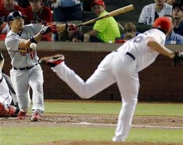 St. Louis Cardinals' Rafael Furcal hits the ball back to Texas Rangers pitcher Derek Holland and grounds out during the third inning of Game 4 of baseball's World Series Sunday, Oct. 23, 2011, in Arlington, Texas. (AP Photo/Eric Gay) By Eric Gay