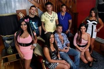 "FILE  - An Aug. 4, 2011 file photo shows the cast members of MTV's ""Jersey Shore"" at their television home in Seaside Heights, N.J.   Fans of sthe television show can rent the house for $2.500 a night.  (AP Photo/Mel Evans/file) By Mel Evans"