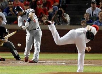 St. Louis Cardinals' Albert Pujols grounds out on a pitch from Derek Holland during the first inning of Game 4 of baseball's World Series Sunday, Oct. 23, 2011, in Arlington, Texas. (AP Photo/Eric Gay) By Eric Gay