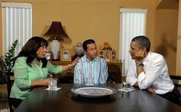 President Barack Obama talks with homeowners Jose and Lissette Bonilla in Las Vegas, Monday, Oct. 24, 2011. Obama is on a three-day trip to the West Coast. (AP Photo/Susan Walsh) By Susan Walsh