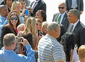 President Barack Obama greets invited guests after exiting Air Force One after arriving at McCarran International Airport in Las Vegas, Monday , Oct. 24, 2011. (AP Photo/John Gurzinski) By John Gurzinski