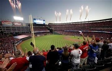 Fans cheer as fireworks are seen before Game 5 of baseball's World Series between the St. Louis Cardinals and the Texas Rangers Monday, Oct. 24, 2011, in Arlington, Texas. (AP Photo/Tony Gutierrez) By Tony Gutierrez