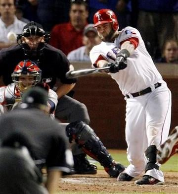 Texas Rangers' Mike Napoli hits a two-RBI double off St. Louis Cardinals' Marc Rzepczynski during the eighth inning of Game 5 of baseball's World Series Monday, Oct. 24, 2011, in Arlington, Texas. (AP Photo/Eric Gay) By Eric Gay