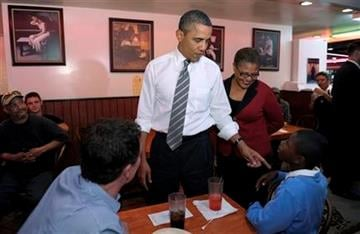 President Barack Obama stops for a snack at Roscoe's House of Chicken and Waffles in Los Angeles, Monday, Oct. 24, 2011. Obama, who was joined by Rep. Karen Bass, D-Calif., is on a three-day trip to the West Coast. (AP Photo/Susan Walsh) By Susan Walsh