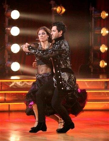 "In this Oct. 17, 2011 photo, soccer player Hope Solo, left, and her partner Maksim Chmerkovskiy perform in the celebrity dance competition series ""Dancing with the Stars,"" in Los Angeles. (AP Photo/ABC, Adam Taylor) By Adam Taylor"