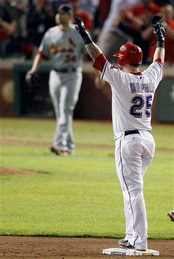 Texas Rangers' Mike Napoli reacts to hitting a two-RBI double off St. Louis Cardinals' Marc Rzepczynski during the eighth inning of Game 5 of baseball's World Series Monday, Oct. 24, 2011, in Arlington, Texas. (AP Photo/Eric Gay) By Eric Gay