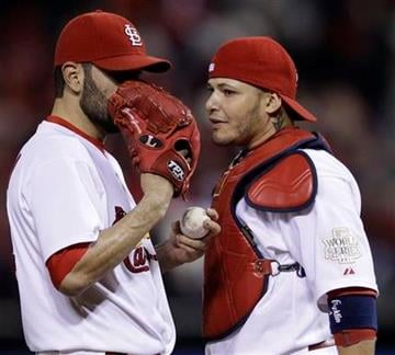 St. Louis Cardinals starting pitcher Jaime Garcia talks to catcher Yadier Molina during the seventh inning of Game 2 of baseball's World Series against the Texas Rangers Thursday, Oct. 20, 2011, in St. Louis. (AP Photo/Matt Slocum) By Matt Slocum