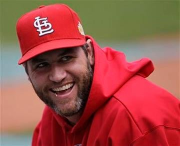 St. Louis Cardinals' Lance Berkman smiles as he stretches before Game 2 of baseball's World Series against the Texas Rangers Thursday, Oct. 20, 2011, in St. Louis. (AP Photo/Paul Sancya) By Paul Sancya