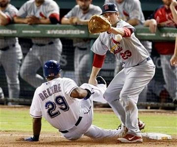 Texas Rangers' Adrian Beltre beats the tag at third from St. Louis Cardinals' David Freese during the seventh inning of Game 3 of baseball's World Series Saturday, Oct. 22, 2011, in Arlington, Texas. (AP Photo/Eric Gay) By Eric Gay