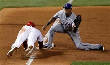St. Louis Cardinals' Matt Holliday is picked off third base with Texas Rangers' Adrian Beltre covering during the sixth inning of Game 6 of baseball's World Series Thursday, Oct. 27, 2011, in St. Louis. (AP Photo/Eric Gay) By Eric Gay