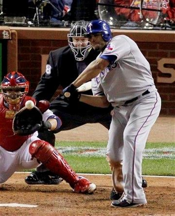 Texas Rangers' Nelson Cruz hits a solo home run off a pitch by St. Louis Cardinals' Lance Lynn during the seventh inning of Game 6 of baseball's World Series Thursday, Oct. 27, 2011, in St. Louis. (AP Photo/Jeff Roberson) By Jeff Roberson