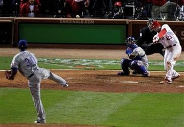 St. Louis Cardinals' David Freese hits a two-run triple off a pitch from Texas Rangers' Neftali Feliz during the ninth inning of Game 6 of baseball's World Series Thursday, Oct. 27, 2011, in St. Louis. (AP Photo/Jeff Roberson) By Jeff Roberson