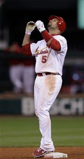 St. Louis Cardinals' Albert Pujols reacts after hitting a double during the ninth inning of Game 6 of baseball's World Series against the Texas Rangers Thursday, Oct. 27, 2011, in St. Louis. (AP Photo/Matt Slocum) By Matt Slocum