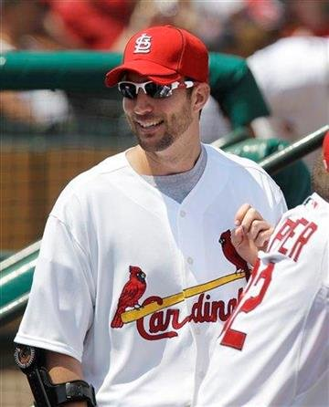 St. Louis Cardinals pitcher Adam Wainwright watches from the dugout during a spring training baseball game against the Washington Nationals, Monday, March 21, 2011 in Jupiter, Fla. (AP Photo/Carlos Osorio) By Carlos Osorio