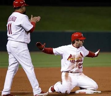 St. Louis Cardinals' David Freese reacts after hitting a two-run triple during the ninth inning of Game 6 of baseball's World Series against the Texas Rangers Thursday, Oct. 27, 2011, in St. Louis. (AP Photo/Matt Slocum) By Matt Slocum