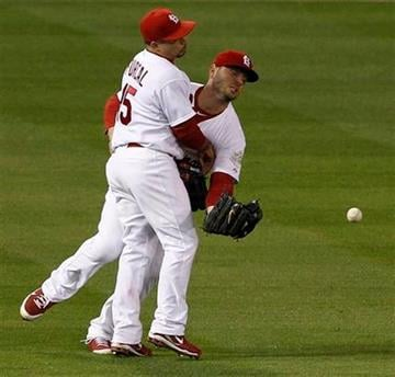 St. Louis Cardinals' Matt Holliday and Rafael Furcal (15) can't come up with a ball hit by Texas Rangers' Nelson Cruz during the fourth inning of Game 6 of baseball's World Series Thursday, Oct. 27, 2011, in St. Louis. (AP Photo/Eric Gay) By Eric Gay