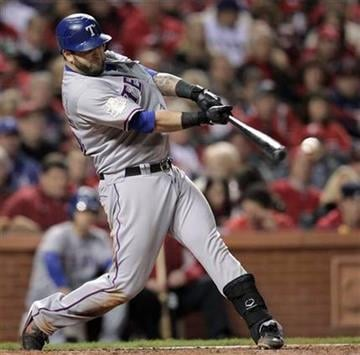 Texas Rangers' Mike Napoli gets a run-scoring hit during the fourth inning of Game 6 of baseball's World Series against the St. Louis Cardinals Thursday, Oct. 27, 2011, in St. Louis. (AP Photo/Charlie Riedel) By Charlie Riedel