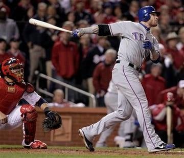 St. Louis Cardinals catcher Yadier Molina watches as Texas Rangers' Josh Hamilton hits a two-run home run during the 10th inning of Game 6 of baseball's World Series Thursday, Oct. 27, 2011, in St. Louis. (AP Photo/Charlie Riedel) By Charlie Riedel