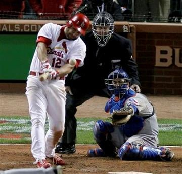 St. Louis Cardinals' Lance Berkman hits a RBI single off a pitch from Texas Rangers' Scott Feldman during the tenth inning of Game 6 of baseball's World Series Thursday, Oct. 27, 2011, in St. Louis. (AP Photo/Jeff Roberson) By Jeff Roberson