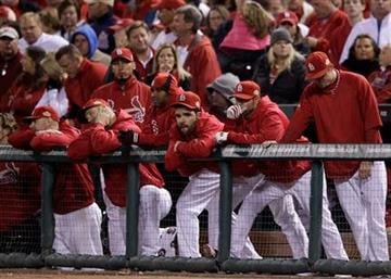The St. Louis Cardinals bench watches during the 10th inning of Game 6 of baseball's World Series against the Texas Rangers Thursday, Oct. 27, 2011, in St. Louis. (AP Photo/Matt Slocum) By Matt Slocum
