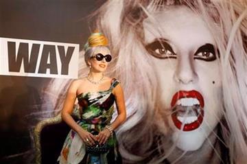 US singer Lady Gaga pose for the media during a press conference in New Delhi, India, Friday, Oct. 28, 2011. (AP Photo/Mustafa Quraishi) By Mustafa Quraishi
