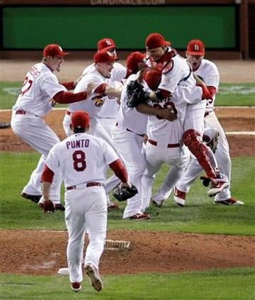 St. Louis Cardinals react after beating the Texas Rangers 6-2 at Game 7 of baseball's World Series Friday, Oct. 28, 2011, in St. Louis. The Cardinals win the series 4-3.  (AP Photo/Jeff Roberson) By Jeff Roberson
