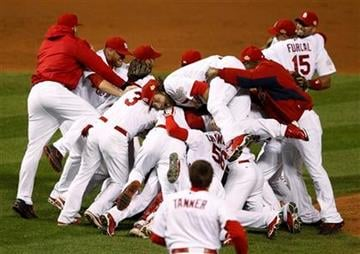 The St. Louis Cardinals celebrate after Texas Rangers' David Murphy hit a fly out to end Game 7 of baseball's World Series Friday, Oct. 28, 2011, in St. Louis. The Cardinals won 6-2 to win the series. (AP Photo/Eric Gay) By Eric Gay