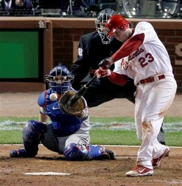St. Louis Cardinals' David Freese hits a solo home run off a pitch by Texas Rangers' Mark Lowe in the 11th inning of Game 6 of baseball's World Series Thursday, Oct. 27, 2011, in St. Louis. The Cardinals won 10-9. (AP Photo/Jeff Roberson) By Jeff Roberson