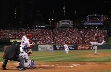 St. Louis Cardinals' David Freese hits a two-run double during the first inning of Game 7 of baseball's World Series against the Texas Rangers Friday, Oct. 28, 2011, in St. Louis. (AP Photo/Ezra Shaw, Pool) By Ezra Shaw