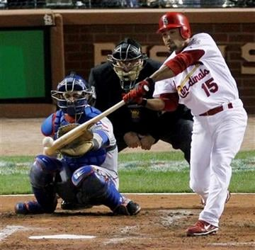 St. Louis Cardinals' Rafael Furcal hits a single during the during the second inning of Game 7 of baseball's World Series against the Texas Rangers, Friday, Oct. 28, 2011, in St. Louis. (AP Photo/Jeff Roberson) By Jeff Roberson