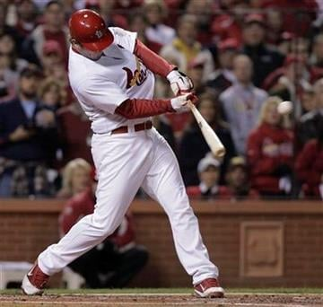 St. Louis Cardinals' David Freese hits a two-run double during the first inning of Game 7 of baseball's World Series against the Texas Rangers Friday, Oct. 28, 2011, in St. Louis. (AP Photo/Charlie Riedel) By Charlie Riedel