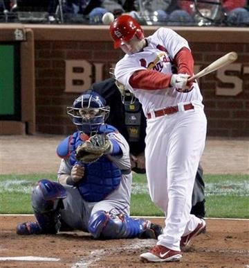 St. Louis Cardinals' David Freese hits a two-run double off Texas Rangers starting pitcher Matt Harrison during the first inning of Game 7 of baseball's World Series Friday, Oct. 28, 2011, in St. Louis. (AP Photo/Jeff Roberson) By Jeff Roberson