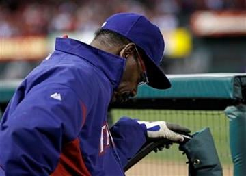 Texas Rangers manager Ron Washington holds his head down in the dugout during the seventh inning of Game 7 of baseball's World Series against the St. Louis Cardinals Friday, Oct. 28, 2011, in St. Louis. (AP Photo/Matt Slocum) By Matt Slocum