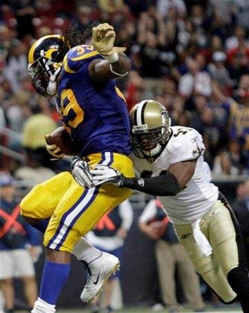 St. Louis Rams running back Steven Jackson, left, makes a touchdown run against New Orleans Saints safety Roman Harper (41) during the third quarter of an NFL football game on Sunday, Oct. 30, 2011, in St. Louis. (AP Photo/Seth Perlman) By Seth Perlman