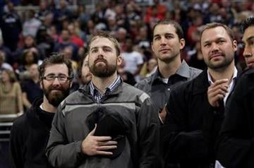 St. Louis Cardinals baseball players stand during the national anthem before an NFL football game between New Orleans Saints and St. Louis Rams on Sunday, Oct. 30, 2011, in St. Louis. (AP Photo/Tom Gannam) By Tom Gannam