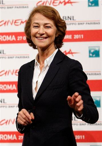 """British actress Charlotte Rampling poses during a photocall to present the movie """"The eye of the storm"""" at the 6th edition of the Rome International Film Festival in Rome, Sunday, Oct. 30, 2011. (AP Photo/Riccardo De Luca) By Riccardo De Luca"""