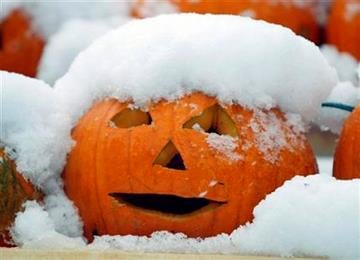 A jack-o'-lantern is covered with snow during a storm, Sunday Oct. 30, 2011, in Freeport, Maine. (AP Photo/Robert F. Bukaty) By Robert F. Bukaty