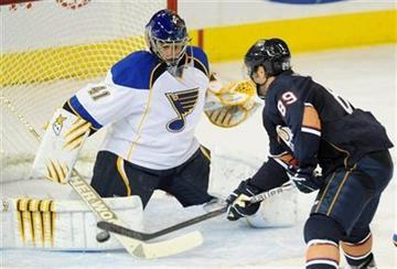 St. Louis Blues goalie Jaroslav Halak makes a save against Edmonton Oilers' Sam Gagner during the third period of an NHL hockey game in Edmonton, Sunday, Oct. 30, 2011. (AP Photo/The Canadian Press, John Ulan) By John Ulan