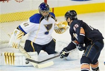 St. Louis Blues goalie Jaroslav Halak makes a save against Edmonton Oilers' Sam Gagner during the third period of an NHL hockey game in Edmonton, Sunday, Oct. 30, 2011. (AP Photo/The Canadian Press, John Ulan) By John Ulan