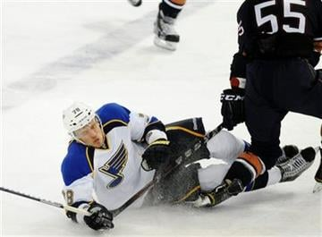 St. Louis Blues' Evgeny Grachev, left, reacts as he falls into the Edmonton Oilers' Ben Eager during the second period of an NHL hockey game in Edmonton on Sunday, Oct. 30, 2011. (AP Photo/The Canadian Press, John Ulan) By John Ulan