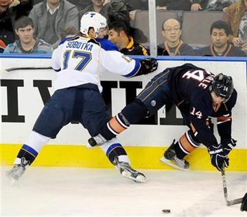 Edmonton Oilers' Jordan Eberle (14) battles with St. Louis Blues' Vladimir Sobotka, of Switzerland, during the first period of an NHL hockey game in Edmonton on Sunday, Oct. 30, 2011. (AP Photo/The Canadian Press, John Ulan) By John Ulan