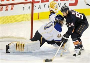 Edmonton Oilers' Ryan Smyth (94) scores on St. Louis Blues goalie Jaroslav Halak during the second period of an NHL hockey game in Edmonton on Sunday, Oct. 30, 2011. (AP Photo/The Canadian Press, John Ulan) By John Ulan